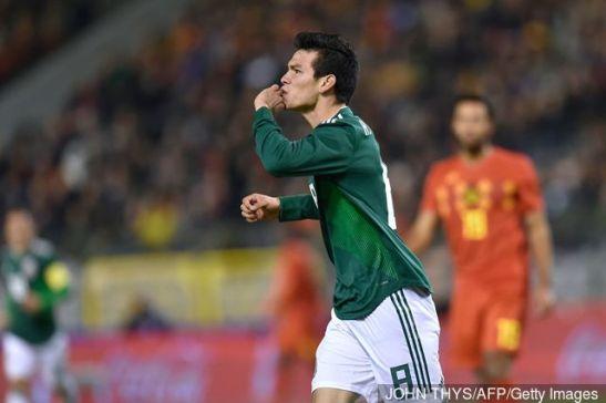 mexicos_forward_hirving_lozano_celebrates_after_scoring_a_goal_d_709875